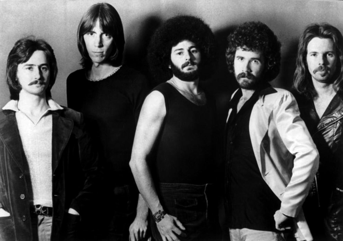 Boston's guitaristTom Scholz, second to left, in a 1977 promo photo.