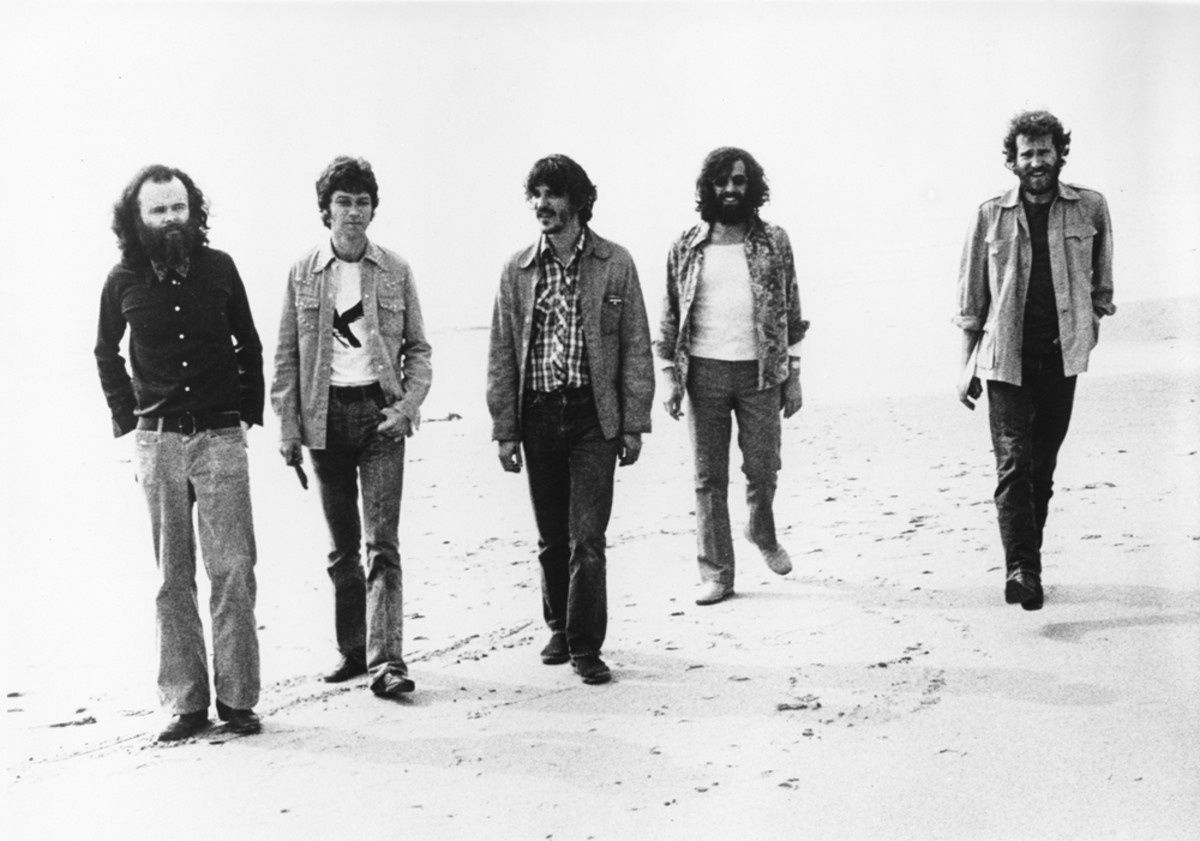 The Band poses for a portrait on the beach at the beginning of the '70s (L-R): Garth Hudson, Robbie Robertson, Rick Danko, Richard Manuel and Levon Helm.Michael Ochs Archives/Getty Images.