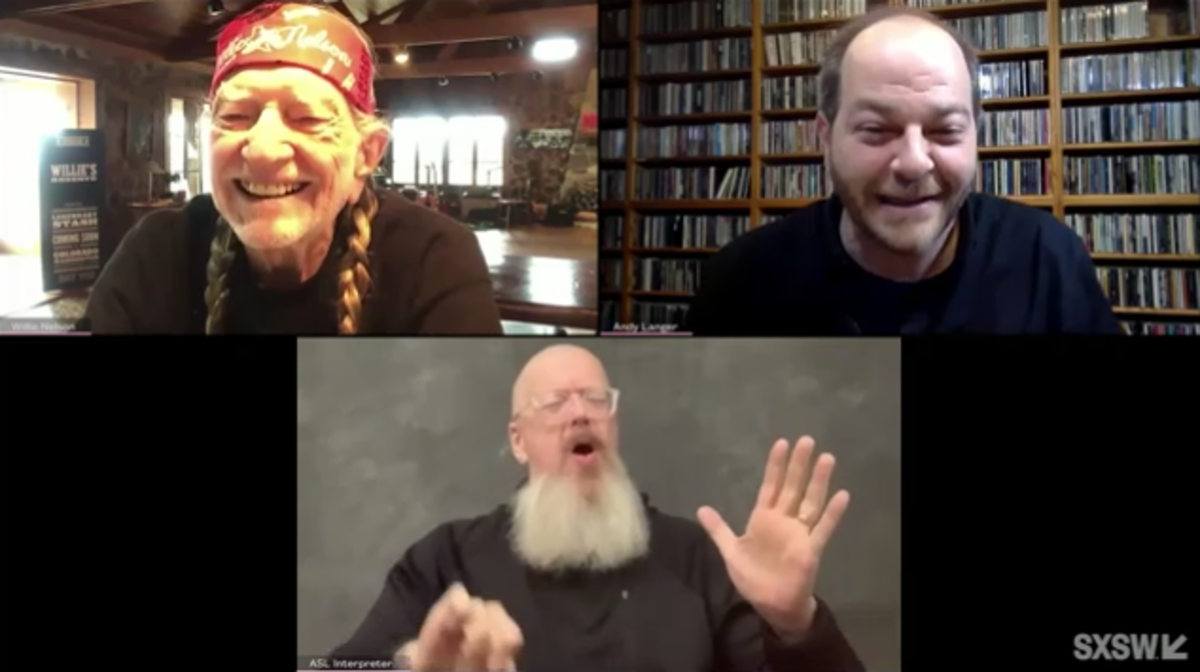 Willie Nelson being interviewed by Andy Langer (top right)