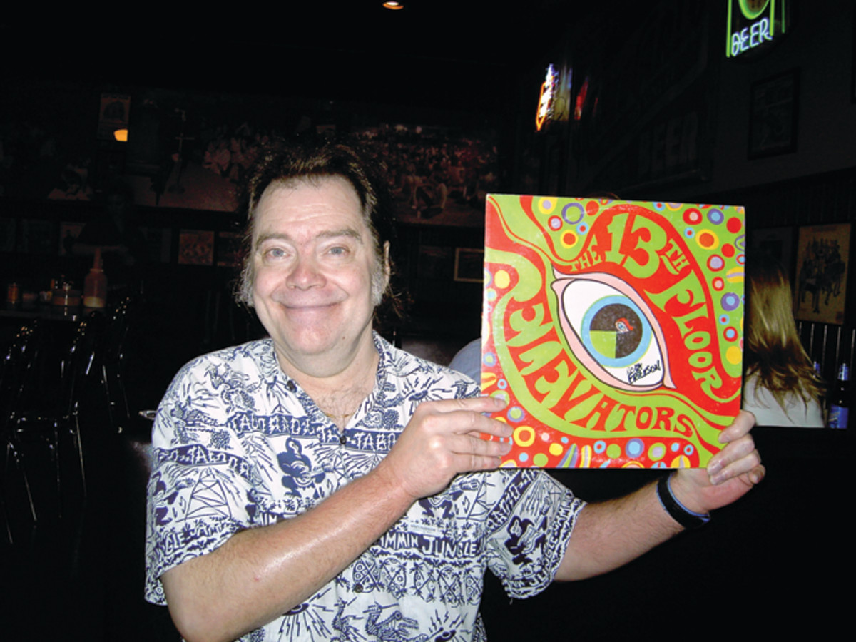 Roky Erickson holding up a 13th Floor Elevators vinyl record. Photo by Rush Evans.