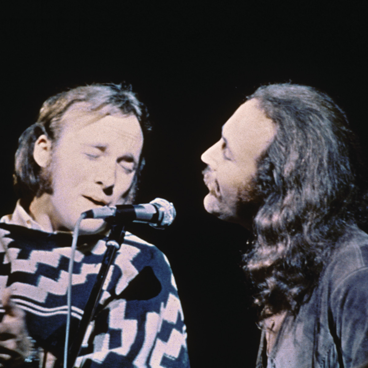 Stephen Stills (left) and David Crosby of the group Crosby, Stills, & Nash performs on stage at the Woodstock Music and Art Festival, Bethel, New York, August 17, 1969. (Photo by Fotos International/Getty Images)