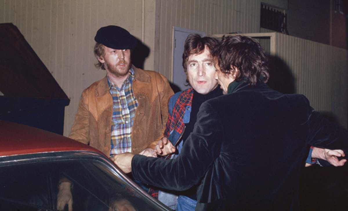 Harry Nilsson with John Lennon, getting thrown out of the Troubadour club in West Hollywood, California, for heckling, during Lennon's much publicized 'lost weekend.' Photo by Maureen Donaldson/Getty Images.