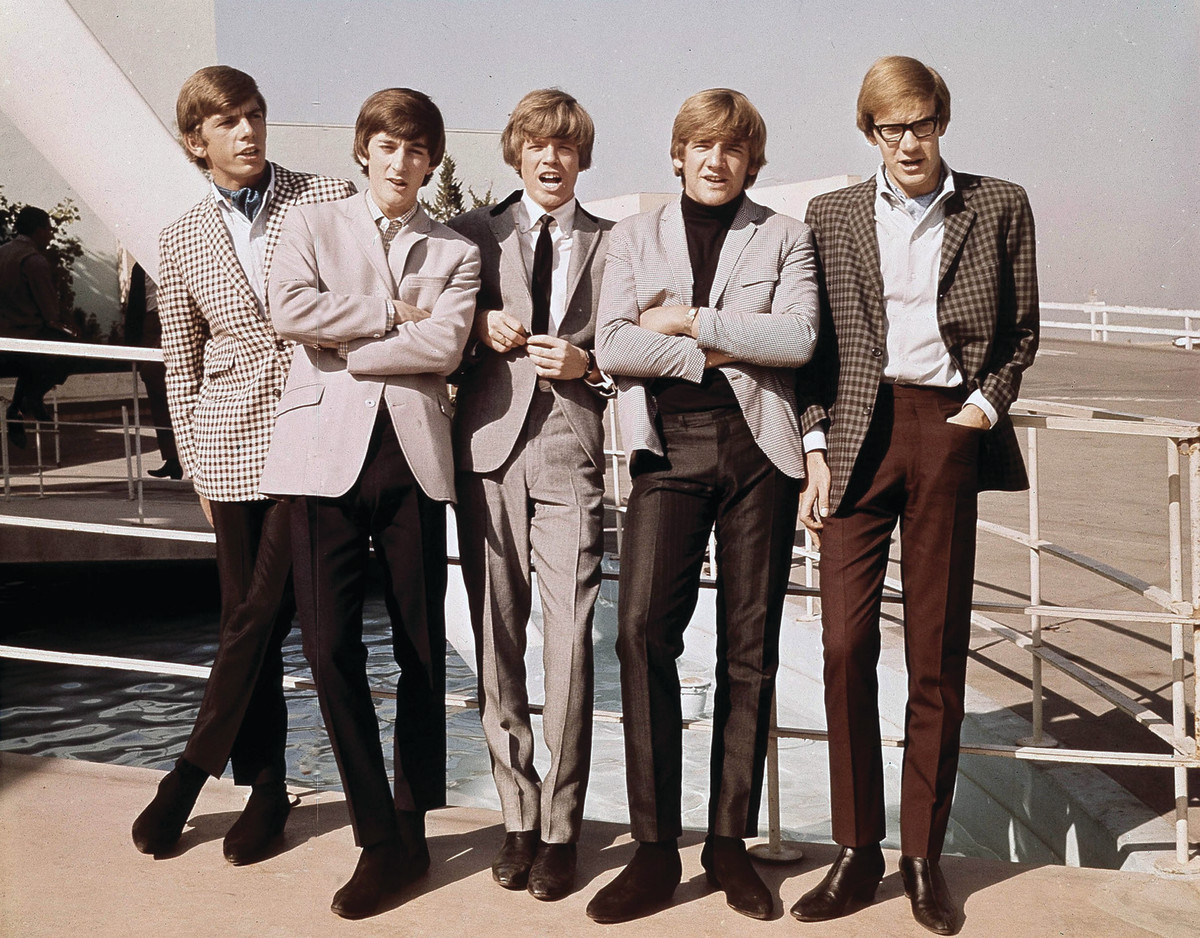 Herman's Hermits (L-R): Barry Whitwam, Keith Hopwood, Peter Noone, Karl Green and Derek Leckenby ham it up for the 1960s U.S. media.