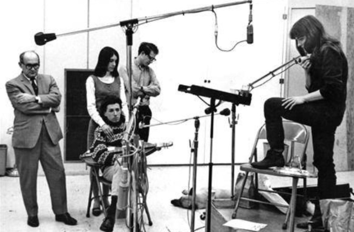 Richard Fariña seated, Judy Collins furthest right at the microphone. 1960s recording studio photo courtesy of Judy Collins.