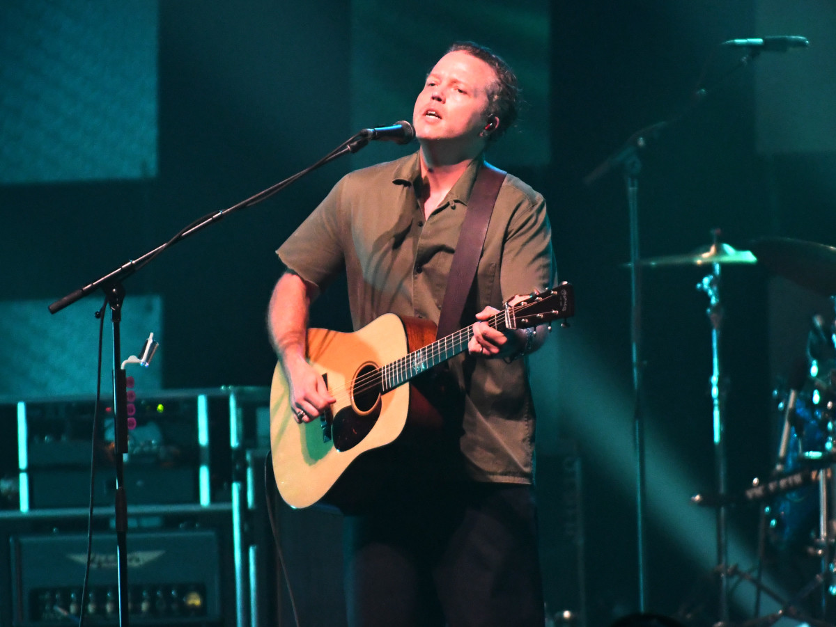 """For """"What've I Done to Help,"""" his show opener in Philadelphia, Jason Isbell started on acoustic guitar, then strapped on an electric to play a slide solo. (Photo by Chris M. Junior)"""